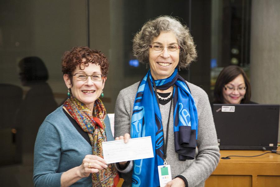 Judith presents Friends donation to VPL Board Chair Mary Lynn Baum.